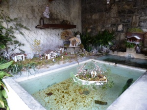 The floating crèche in the laundry trough near the Iera castle tower at the top of the village