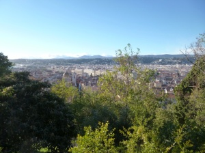 The beautiful view from the waterfall over the city of Nice and the moutains to the west