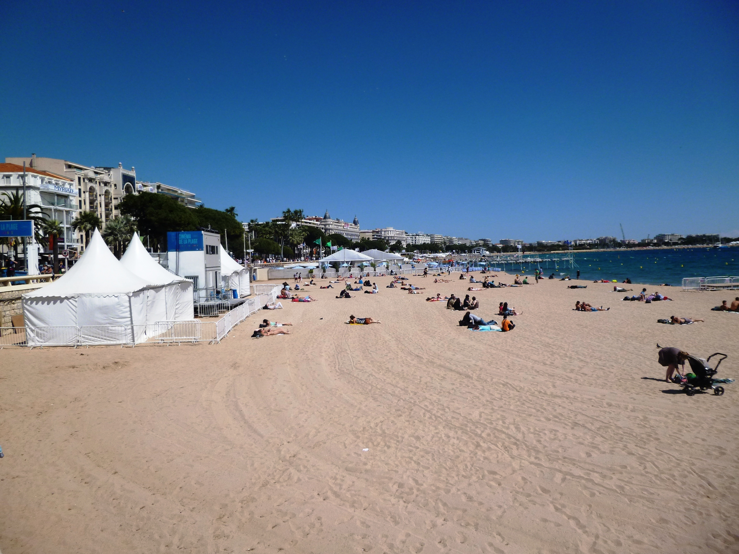 The stunning sandy beach of Cannes, just underneath the Croisette promenade