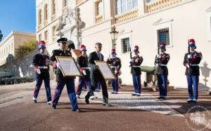 The head of the Public Forces, Colonel Fringant and the Prince's Chamberlain, Lt-Colonel Soler, nailing the proclamation to the Palace doors (C) Palais Princier de Monaco